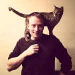 Brent Amberger with cat on his shoulders